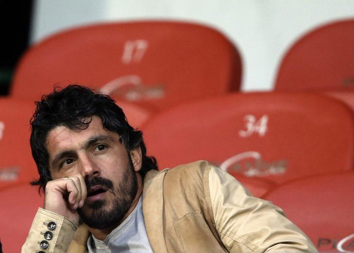 Injured FC Sion player Gennaro Gattuso sits in the tribune before the start of the second half of their Swiss Super League soccer match against Grasshopper (GC) in Sion May 16, 2013.  REUTERS/Denis Balibouse/Files