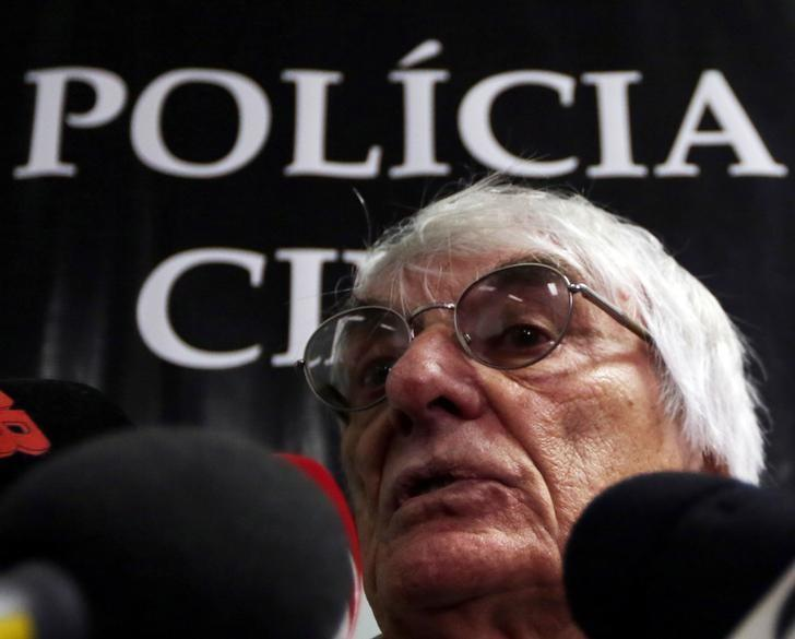 Formula One chief Bernie Ecclestone talks to the media in police central station in Sao Paulo, Brazil, August 8, 2016. Ecclestone visited the station to thank police for the rescue of his kidnapped mother-in-law Aparecida Schunk. REUTERS/Paulo Whitaker/Files