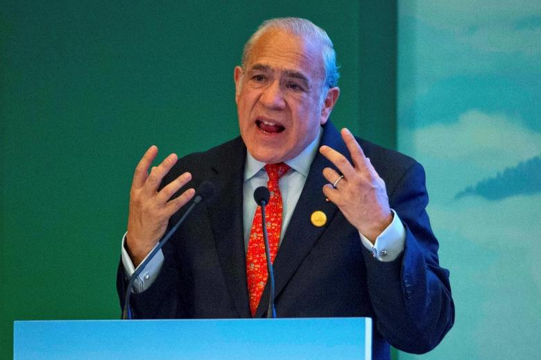 Angel Gurria, Secretary-General of OECD speaks on stage at the High-level Tax Symposium held in Chengdu, China, July 23, 2016. REUTERS/Ng Han Guan/Pool/File Photo
