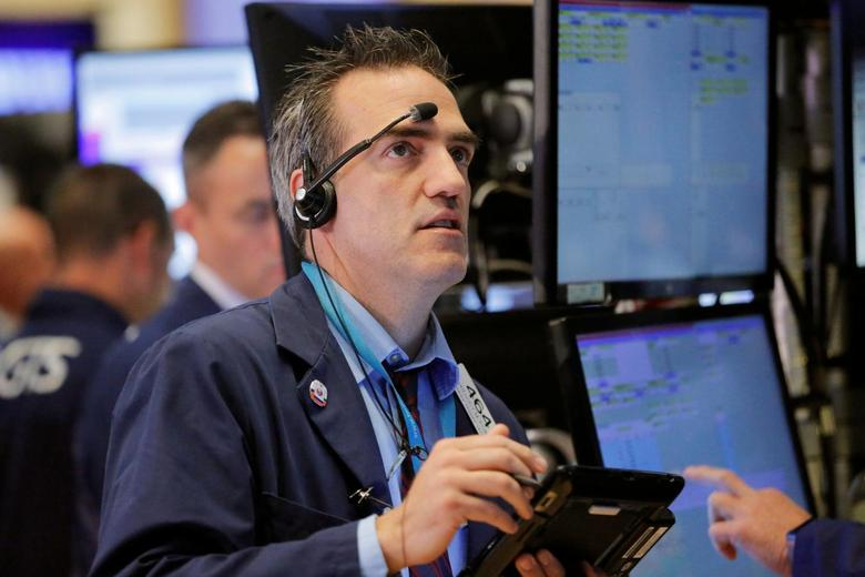 A trader works on the floor of the New York Stock Exchange (NYSE) shortly after the opening bell in New York, U.S., August 30, 2016. REUTERS/Lucas Jackson