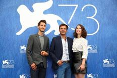 "Director Francois Ozon poses with actors Pierre Niney, Paula Beer as they attend the photocall for the movie ""Frantz"" at the 73rd Venice Film Festival in Venice, Italy September 3, 2016. REUTERS/Alessandro Bianchi"