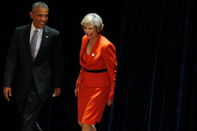 U.S. President Barack Obama and Britain's Prime Minister Theresa May arrive to speak to reporters after their bilateral meeting alongside the G20 Summit, in Ming Yuan Hall at Westlake Statehouse in Hangzhou, China September 4, 2016. REUTERS/Jonathan Ernst