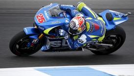 Suzuki Ecstar MotoGP rider Maverick Vinales of Spain rides during free practice 3 before the Australian Grand Prix on Phillip Island, October 17, 2015. REUTERS/Brandon Malone