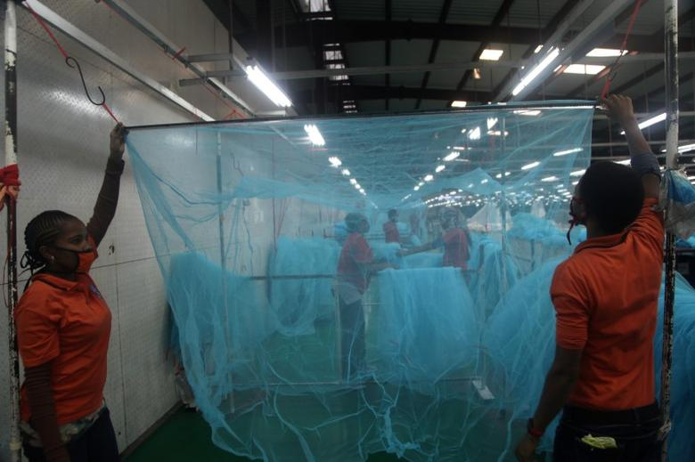 Workers look for abnormal holes in mosquito netting at the A to Z Textile Mills factory producing insecticide-treated bednets in Arusha, Tanzania, May 10, 2016. REUTERS/Katy Migiro