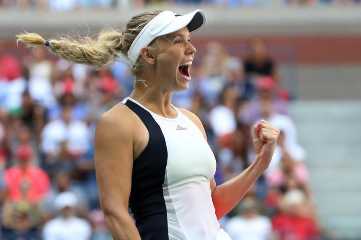 Sep 4, 2016; New York, NY, USA; Caroline Wozniacki of Denmark celebrates after winning match point against Madison Keys of the United States (not pictured) on day seven of the 2016 U.S. Open tennis tournament at USTA Billie Jean King National Tennis Center. Wozniacki won 6-3, 6-4. Mandatory Credit: Geoff Burke-USA TODAY Sports