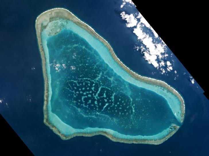 Boats at Scarborough Shoal in the South China Sea are shown in this handout photo provided by Planet Labs, and captured on March 12, 2016. REUTERS/Planet Labs/Handout via Reuters/Files