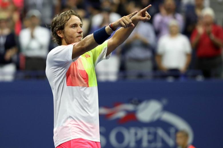 Sep 4, 2016; New York, NY, USA; Lucas Pouille of France celebrates after winning match point against Rafael Nadal of Spain (not pictured) on day seven of the 2016 U.S. Open tennis tournament at USTA Billie Jean King National Tennis Center. guile won 6-1, 2-6, 6-4, 3-6, 7-6(6). Mandatory Credit: Geoff Burke-USA TODAY Sports