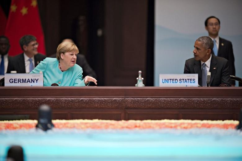 German Chancellor Angela Merkel (L) chats with US President Barack Obama during the opening of the G20 Summit in Hangzhou, Zhejiang province, China, September 4, 2016. REUTERS/Nicolas Asfonri/Pool