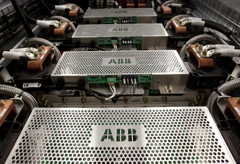 The company's logo is seen on protection grids of a traction transformer at a plant of Swiss engeneering group ABB in the town of Turgi west of Zurich June 9, 2010.   REUTERS/Arnd Wiegmann/File Photo