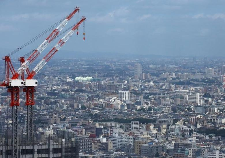 Cranes on a construction site is seen in Tokyo, Japan, August 21, 2016. Picture taken on August 21, 2016.   REUTERS/Kim Kyung-Hoon