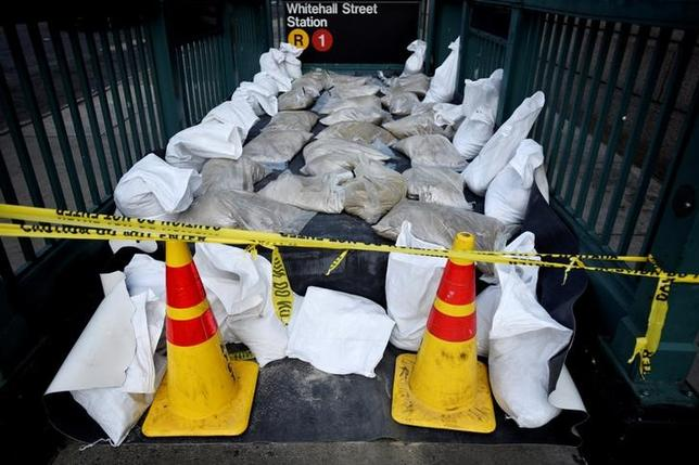 Sandbags and tarps cover the entrance to a subway station near Battery Park as New York City prepares for potential flooding as post-tropical storm Hermine stalls off the east coast of the United States, September 4, 2016.  REUTERS/Mark Kauzlarich