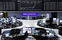 Traders work at their desks in front of the German share price index, DAX board, at the stock exchange in Frankfurt, Germany, September 2, 2016. REUTERS/Staff/Remote
