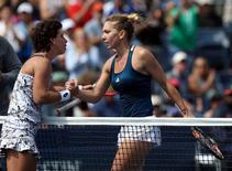 Sep 5, 2016; New York, NY, USA; Simona Halep of Romania (right) shakes hands with Carla Suarez Navarro of Spain after their match on day eight of the 2016 U.S. Open tennis tournament at USTA Billie Jean King National Tennis Center. Mandatory Credit: Jerry Lai-USA TODAY Sports