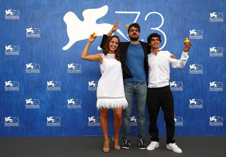 Director Roan Johnson (C) poses with actors Blu Yoshimi (L) and Luigi Fedele as they attend the photocall for the movie ''Piuma'' at the 73rd Venice Film Festival in Venice, Italy September 5, 2016. REUTERS/Alessandro Bianchi