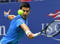 Novak Djokovic of Serbia hits to Kyle Edmund of the UK. Mandatory Credit: Robert Deutsch-USA TODAY Sports