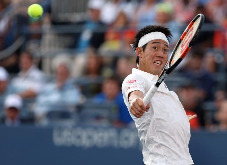 Sep 5, 2016; New York, NY, USA; Kei Nishikori of Japan hits a shot to Ivo Karlovic of Croatia on day eight of the 2016 U.S. Open tennis tournament at USTA Billie Jean King National Tennis Center. Mandatory Credit: Jerry Lai-USA TODAY Sports