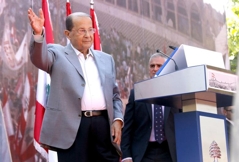 Lebanese Christian leader and founder of the Free Patriotic Movement (FPM) Michel Aoun greets his supporters during a rally to show support for him and to mark the October 13 anniversary, near the presidential palace in Baabda, near Beirut, Lebanon October 11, 2015. REUTERS/Mohamed Azakir/Files