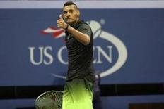 Nick Kyrgios of Australia mockingly gestures to his player's box while battling with an injury in the third set against Ilya Marchenko of Ukraine (not pictured) on day six of the 2016 U.S. Open tennis tournament at USTA Billie Jean King National Tennis Center. Geoff Burke-USA TODAY Sports