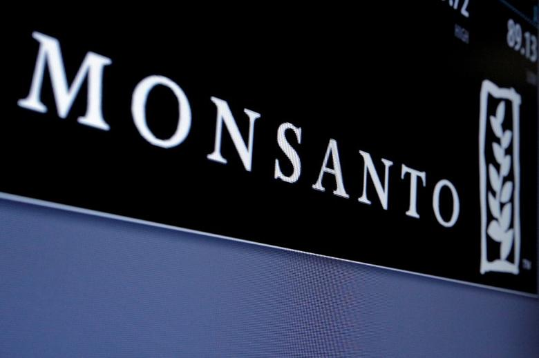 Monsanto logo is displayed on a screen where the stock is traded on the floor of the New York Stock Exchange (NYSE) in New York City, U.S. on May 9, 2016. REUTERS/Brendan McDermid/File Photo  - RTX2O9ND