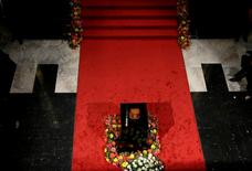 An urn containing the ashes of Juan Gabriel during his homage is seen beside flowers in the Bellas Artes Palace in Mexico City, Mexico September 5, 2016. REUTERS/Henry Romero