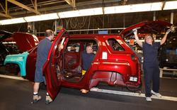 CAMI Automotive Inc. employees assemble a 2010 GMC Terrain after a C$90 million investment announcement was made in Ingersoll November 9, 2009.  REUTERS/Mike Cassese