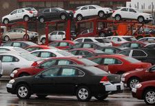 Newly built cars sit in a shipping lot near  General Motors Car assembly plant in Oshawa, June 1, 2012. REUTERS/Mark Blinch