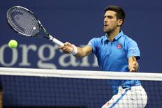 Sep 6, 2016; New York, NY, USA; Novak Djokovic of Serbia hits a volley against Jo-Wilfried Tsonga of France (not pictured) on day nine of the 2016 U.S. Open tennis tournament at USTA Billie Jean King National Tennis Center. Mandatory Credit: Geoff Burke-USA TODAY Sports