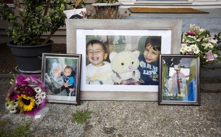 Photographs of Aylan Kurdi and Galip Kurdi, who were among 12 people who drowned in Turkey trying to reach Greece, are pictured outside of Tima Kurdi's home in Coquitlam, British Columbia September 3, 2015.  REUTERS/Ben Nelms/Files
