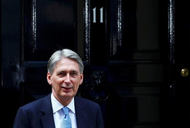 Britain's new Chancellor of the Exchequer, Philip Hammond, waits to greet U.S. Treasury Secretary Jack Lew, at number 11 Downing Street in London, Britain July 14, 2016.  REUTERS/Neil Hall/File Photo