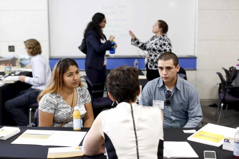 Job seekers work with recruiters at GRID Alternatives solar job fair in San Francisco, California, U.S. July 15, 2015.   REUTERS/Robert Galbraith/File Photo