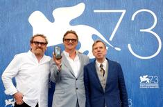 "Director Nick Hamm (C) poses with actors Colm Meaney  (L) and Timothy Spall as they attend the photocall for the movie ""The Journey"" at the 73rd Venice Film Festival in Venice, Italy September 7, 2016. REUTERS/Alessandro Bianchi"