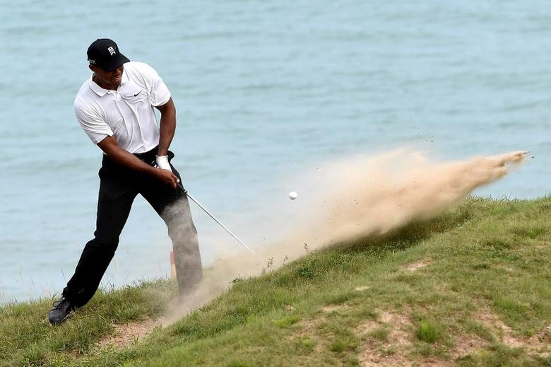 Aug 14, 2015; Sheboygan, WI, USA;  Tiger Woods plays from the sand on the 4th hole during the second round of the 2015 PGA Championship golf tournament at Whistling Straits. Michael Madrid-USA TODAY Sports