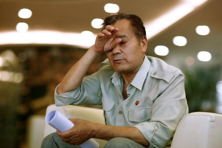 Wang Shiji, founder of the Defend Mao Zedong People's Party, reacts during an interview in Beijing, China, August 21, 2016. REUTERS/Thomas Peter/Files