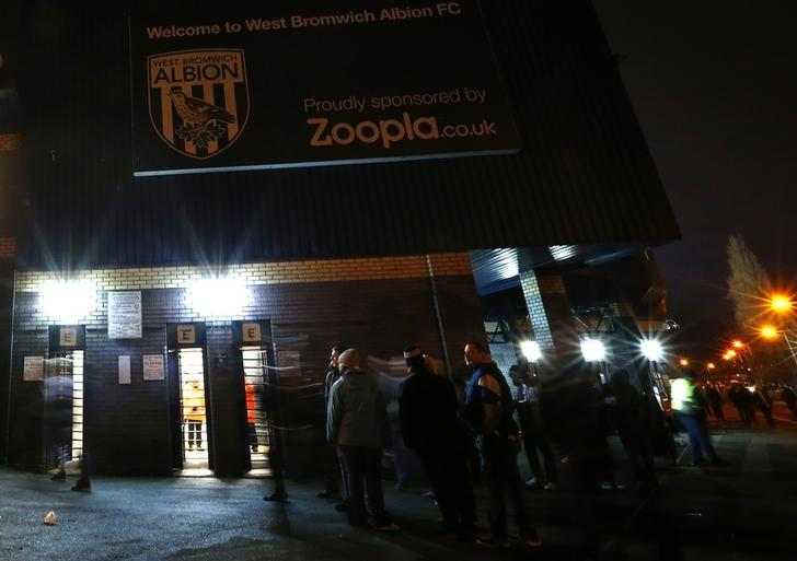 West Bromwich Albion fans gather below a Zoopla sign before their English Premier League soccer match against Everton at the Hawthorns in West Bromwich, central England, January 20, 2014. REUTERS/Darren Staples