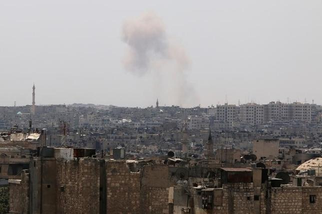Smoke rises from Ramousah as seen from a rebel-held area of Aleppo, Syria, August 22, 2016. REUTERS/Abdalrhman Ismail/Files