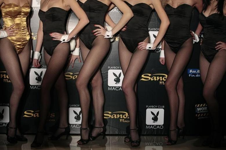 Models pose for a picture during a promotional event for the upcoming opening of the Playboy club in Macau October 15, 2010. REUTERS/Tyrone Siu/Files