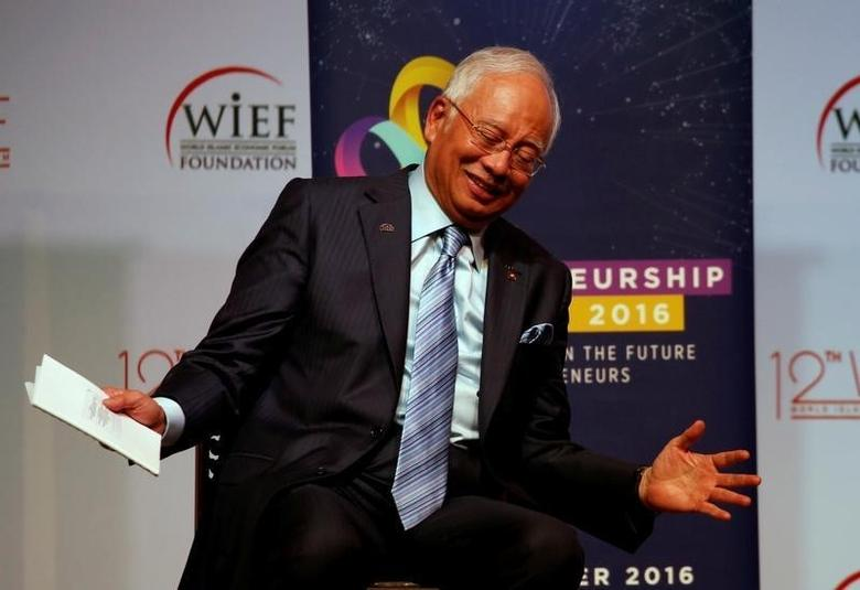 Malaysia's Prime Minister Najib Razak gestures as he sits beside Musa Hitam, the chairman of the WIEF Foundation (unseen) at the 12th World Islamic Economic Forum before talking to the media in Jakarta, Indonesia, August 3, 2016. REUTERS/Beawiharta/Files