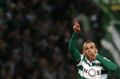Football Soccer - Sporting v Porto - Portuguese Premier League - Alvalade Stadium, Lisbon, Portugal - 02/01/2016   Sporting's Islam Slimani celebrates his goal after scoring against Porto. REUTERS/Hugo Correia/Files