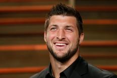 Former NFL player Tim Tebow arrives at the 2014 Vanity Fair Oscars Party in West Hollywood, California, U.S. on March 2, 2014. REUTERS/Danny Moloshok/File Photo