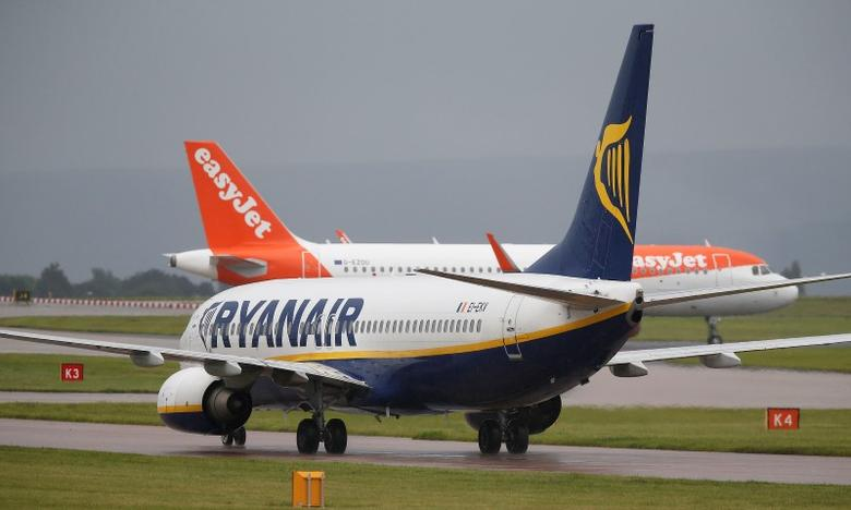 A Ryanair aircraft taxis behind an easyJet aircraft at Manchester Airport in Manchester, Britain June 28, 2016. REUTERS/Andrew Yates