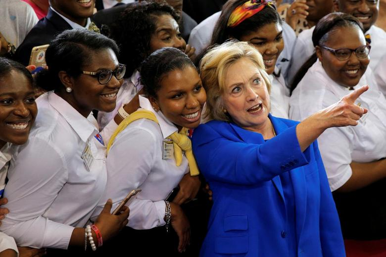 U.S. Democratic presidential candidate Hillary Clinton greets students during a campaign voter registration event at Johnson C. Smith University in Charlotte, North Carolina, United States September 8, 2016.  REUTERS/Brian Snyder