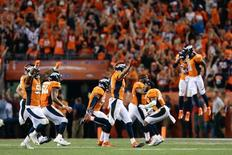 Sep 8, 2016; Denver, CO, USA; Denver Broncos players celebrate after a missed field goal attempt  by the Carolina Panthers in the fourth quarter at Sports Authority Field at Mile High. Mandatory Credit: Isaiah J. Downing-USA TODAY Sports