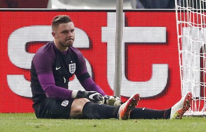 Football Soccer - Germany v England - International Friendly - Olympiastadion, Berlin, Germany - 26/3/16England's Jack Butland looks dejected after sustaining a injury and is later stretchered offAction Images via Reuters / Carl Recine