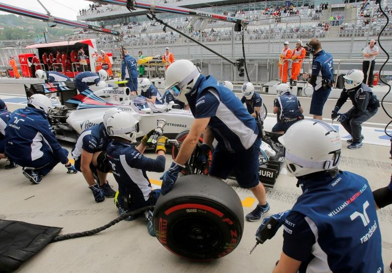 Formula One - Russian Grand Prix - Sochi, Russia - 30/4/16 - Williams F1 driver Valtteri Bottas of Finland sits in his car during the third practice session as mechanics change the tyres.REUTERS/Maxim Shemetov