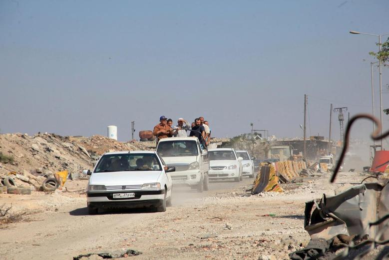People drive in the Ramousah area of southern Aleppo, after the Syrian army and allied militia advanced in the area, Syria, in this handout picture provided by SANA on September 9, 2016. SANA/Handout via REUTERS