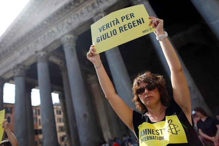 An Amnesty International activist holds a placard reading ''truth for Giulio Regeni'' as she takes part in a performance to protest against enforced disappearance in Rome, Italy July 13, 2016. To match Special Report EGYPT-REGENI/ REUTERS/Staff/File Photo
