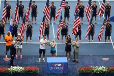 Sep 9, 2016; New York, NY, USA; Laura Siegemund of Germany and Mate Pavic of Croatia hold the championship trophy after the match against Coco Vandeweghe and Rajeev Ram of the United States in the Mixed Doubles Finals on day twelve of the 2016 U.S. Open tennis tournament at USTA Billie Jean King National Tennis Center. Anthony Gruppuso-USA TODAY Sports