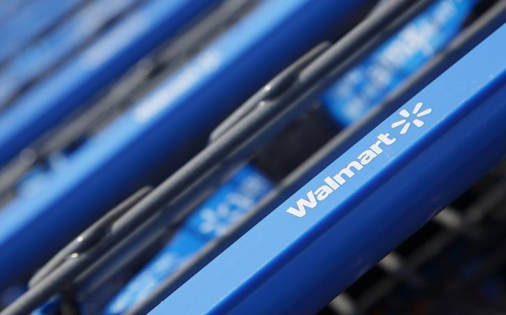 Shopping carts are seen outside a new Wal-Mart Express store in Chicago July 26, 2011. REUTERS/John Gress/Files - RTSEZP9