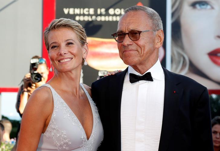 Director Andrei Konchalovsky (R) poses with actress Julia Vysotskaya as they attend the red carpet for the movie ''Paradise'' at the 73rd Venice Film Festival in Venice, Italy September 8, 2016. REUTERS/Alessandro Bianchi