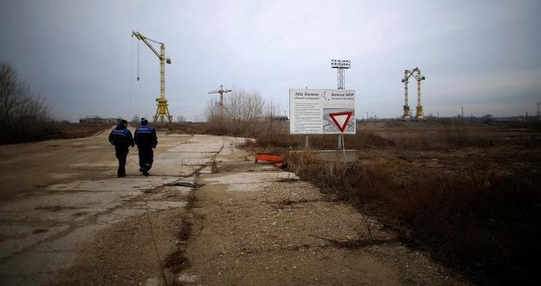 Workers walk near the construction site of Bulgaria's second nuclear power plant in Belene, Bulgaria, January 24, 2013. REUTERS/Stoyan Nenov/File Photo
